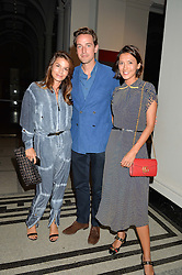 Left to right, SIBYLLE ROCHAT, ALEX GILKES and HIKARI YOKOYAMA at a private view of Revolution: Records and Rebels 1966-1970 at the V&A, London on 7th September 2016.