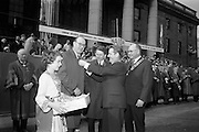 17/3/1966<br /> 3/17/1966<br /> 17 March 1966<br /> <br /> Mr. Sean O'Bradaigh(2nd from right)Vice President NAIDA pinning shamrock on the lapel of Mr. Douglas Watson, Chief Marshal, Lord Mayor's Show Belfast as he was welcomed to the Review Platform prior to the parade.<br /> Also in the Picture are Mr. H.A. Hadden(centre) Vice President Belfast Junior Chamber of Commerce and Chairman Lord Mayor's Ahow Belfast; Mr. E. Sydney Gibbons(right) President of the Federation of Irish Industries and Nolan