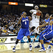 Central Florida guard Marcus Jordan (5) drives to the basket against Memphis forward Will Coleman (0) during a Conference USA NCAA basketball game between the Memphis Tigers and the Central Florida Knights at the UCF Arena on February 9, 2011 in Orlando, Florida. Memphis won the game 63-62. (AP Photo: Alex Menendez)