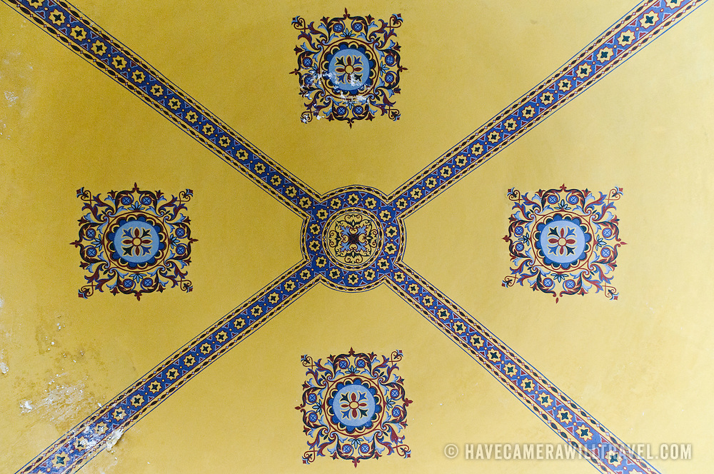 A geometric pattern at the center of one of the smaller domed ceilings on the second floor of Hagia Sophia. Originally built as a Christian cathedral, then converted to a Muslim mosque in the 15th century, and now a museum (since 1935), the Hagia Sophia is one of the oldest and grandest buildings in Istanbul. For a thousand years, it was the largest cathedral in the world and is regarded as the crowning achievement of Byzantine architecture.