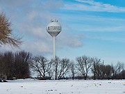 "25 FEBRUARY 2020 - BUTTERFIELD, MINNESOTA: The water tower of the edge of town in Butterfield, MN, a farming community of about 500 people 130 miles southwest of the Twin Cities. The town has been a ""food desert"" for 10 years after its only grocery store closed in 2010. Barb Mathistad Warner and Mark Warner purchased the True Value store in Butterfield in December, 2018 and started selling groceries in the store in May, 2019. For residents of Butterfield going to a grocery store meant driving 10 miles to St. James, MN, or 20 miles to Windom, MN, the two nearest communities with grocery stores. The USDA defines rural food deserts as having at least 500 people in a census tract living 10 miles from a large grocery store or supermarket. There is a convenience store in Butterfield, but it sells mostly heavily processed, unhealthy snack foods that are high in fat, sugar, and salt.   PHOTO BY JACK KURTZ"