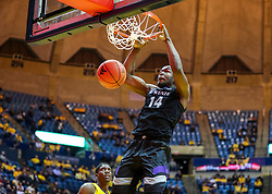 Feb 18, 2019; Morgantown, WV, USA; Kansas State Wildcats forward Makol Mawien (14) dunks the ball during the first half against the West Virginia Mountaineers at WVU Coliseum. Mandatory Credit: Ben Queen-USA TODAY Sports