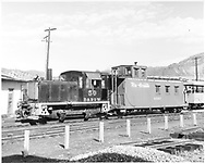 Diesel switcher #50 and caboose #0587.  Short pieces of assembled track in foreground.  Excursion car in background.<br /> D&RGW  Durango, CO