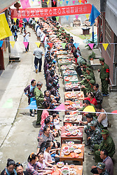 August 1, 2018 - Congjiang, China - Veterans enjoy the long table feast in Congjiang, southwest China's Guizhou Province, marking the Army Day. China's Army Day is celebrated on August 1st every year to commemorate the foundation of  People's Liberation Army (PLA) (Credit Image: © SIPA Asia via ZUMA Wire)