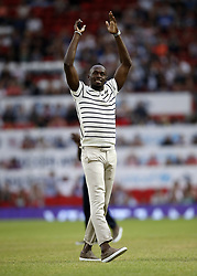 World XI's Usain Bolt applauds fans prior to the UNICEF Soccer Aid match at Old Trafford, Manchester.
