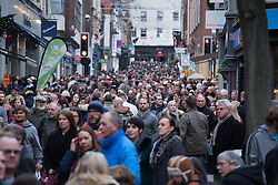 © Licensed to London News Pictures. 3/12/2016. Lincoln, UK. Thousands of people descended upon Lincoln over the weekend to start their Christmas shopping and visit the annual Christmas market. With over 200 stalls surrounding the Cathedral and Castle in the uphill area a one way system to control visitors had to be put in place due to the huge crowds thronging the City Centre. Picture shows the High Street looking up to the Cathedral. Photo credit: Dave Warren/LNP