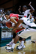 SHOT 2/23/10 10:36:20 PM - Colorado State players try to trap New Mexico's Darington Hobson along the sidelines during the second half of their regular season Mountain West Conference game at Moby Arena in Fort Collins, Co. New Mexico survived a tight game winning 72-66. (Photo by Marc Piscotty / © 2010)