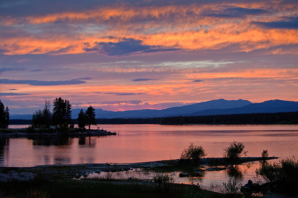 Island Lake Dam Reservoir in Eastern Idaho in the American West near Yellowstone National Park. Brilliant sunset on a summer evening.  Licensing and Open Edition Prints.