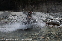 Bear Haughton racing through a water crossing on Day-7 of our Himalayan Heroes adventure riding from Tatopani to Pokhara, Nepal. Monday, November 12, 2018. Photography ©2018 Michael Lichter.