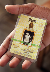 Judeson Britto Moses, 28, holds the identity card of his sister Poline Carmel Moses, Batticaloa, Sri Lanka, Jan. 30, 2005. Moses' sister died along with the rest of his immediate family in the tsunami that hit his beach village.