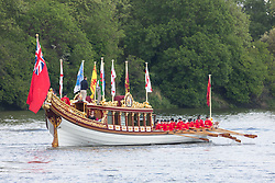© Licensed to London News Pictures. 13/05/2018. Putney, UK. Queen's row barge Gloriana pictured on the Thames at Putney as she begins rows all the way to the Tower of London from Hampton Court with a small flotilla of traditional Thames craft. The Tudor Pull is an annual event on the river. Photo credit : Rob Powell/LNP