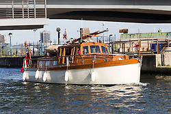 © Licensed to London News Pictures. 16/05/2015. London, UK. Dunkirk Little Ship, Hilfranor arrives in Royal Victoria Dock in London today. Over 20 Dunkirk Little Ships have gathered in London toay before leaving in the morning to continue their journey to Dunkirk to mark the 75th anniversary of the Dunkirk Evacuations. Photo credit : Vickie Flores/LNP