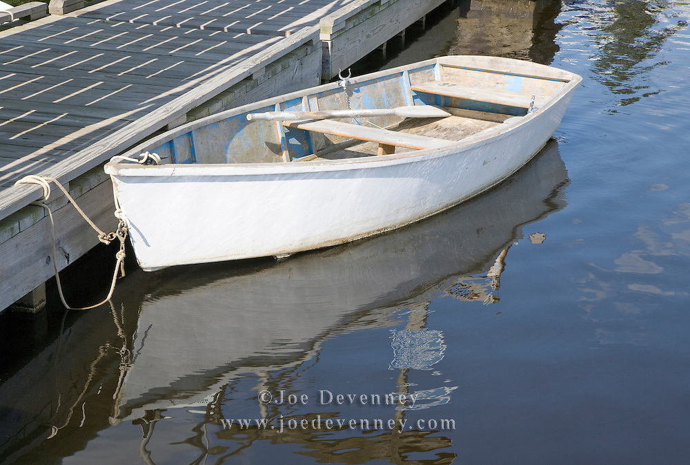 Rowboat tied to the dock at the Ellsworth Harbor public boat landing.