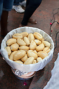 Basket of bread as an offering. Often the lines between Candomble and Catholicism are blurred. This is especially true with the Sao Lazaro event in late January in Salvador, Bahia, Brazil, the city which is known as the home of Candomble. Sao Lazaro represents healing and the sick.