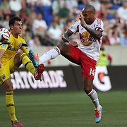 Bernardo Anor, (left), Columbus Crew, and Thierry Henry, New York Red Bulls, challenge for the ball during the New York Red Bulls Vs Columbus Crew, Major League Soccer regular season match at Red Bull Arena, Harrison, New Jersey. USA. 12th July 2014. Photo Tim Clayton