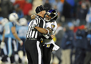 Jan 10, 2009; Nashville, Tennessee, USA;  Baltimore Ravens Cornerback Corey Ivy hugs back judge Bob Lawing after the Ravens stopped the Tennessee Titans on fourth down to win the AFC Divisional Playoff 13-10 to advance to the AFC Championship Game against Pittsburgh.