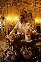 1997, Monte-Carlo, Monaco --- World famous chef Alain Ducasse displays a table piled with baskets of rolls, breads, and breadsticks at his Monte Carlo Restaurant. --- Image by © Owen Franken/CORBIS