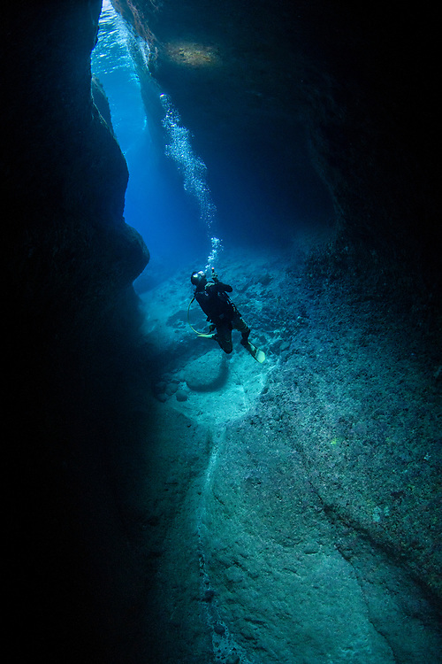 Diver in the Catherdral, a famous underwater cavern, Green Island, Taiwan.<br />The island is a small volcanic island in the Pacific Ocean famous for clear water, coral reefs and marine life in abundance.