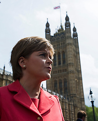 © London News Pictures. 11/05/2015. Leader of the SNP Nicola Sturgeon  outside the St Stephens Entrance to the Houses of Parliament as 56 SNP Members of Parliament arrive at Westminster following their election sucess. Photo credit: Ben Cawthra/LNP