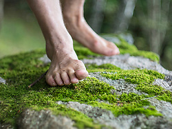 Low section of man hiking barefoot in Middle Black Forest Baden-Wuerttemberg, Germany