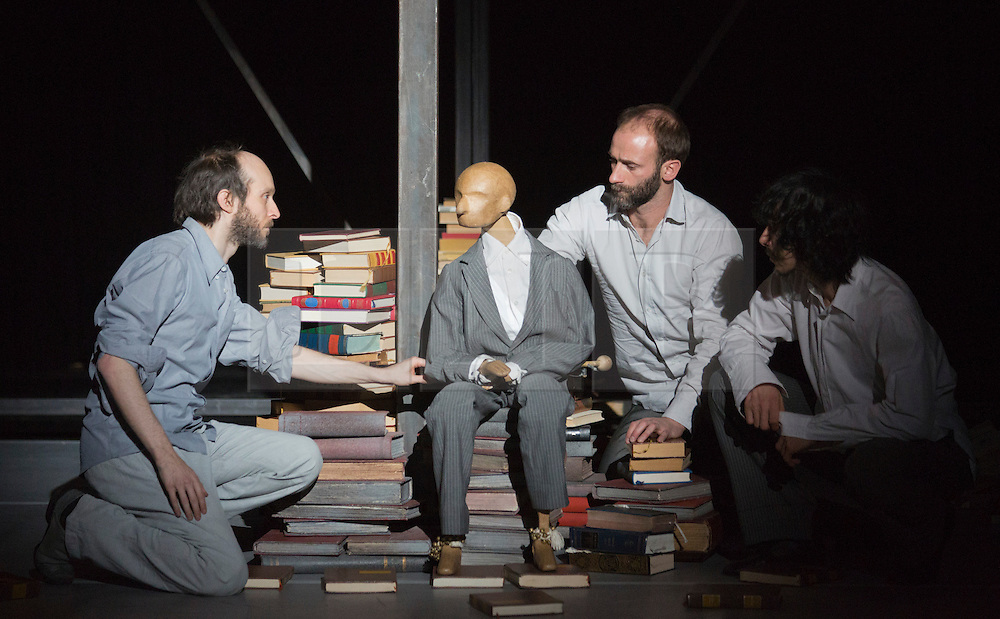 """© Licensed to London News Pictures. 24/01/2014. London, England. L-R: Sidi Larbi Cherkaoui, Dimitri Jourde and Yasuyuki Shuto with a puppet. Belgian dancer/choreographer Sidi Larbi Cherkaoui's work """"Apocrifu"""" uses the language of the body to explore apocryphal religious texts, accompanied by the polyphonic singing from the all-male Corsican vocal ensemble """"A Filetta"""". Dancers: Sidi Larbi Cherkaoui, Dimitri Jourde and Yasuyuki Shuto. Performances at the Queen Elizabeth Hall, Southbank Centre from 24th to 25the January 2014. Photo credit: Bettina Strenske/LNP"""