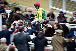 Robbie Power on Sizing John celebrates after winning the Timico Cheltenham Gold Cup Chase during Gold Cup Day of the 2017 Cheltenham Festival at Cheltenham Racecourse.