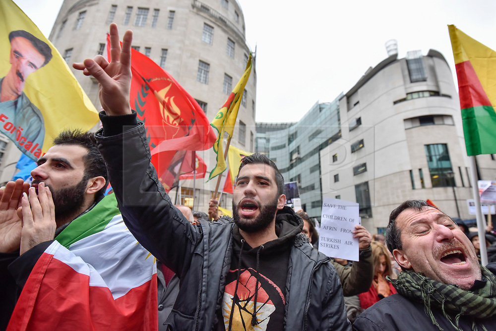 © Licensed to London News Pictures. 27/01/2018. LONDON, UK.  Protesters chant outside the BBC as thousands of Kurdish people march from the BBC's Headquarters in Portland Place to Downing Street to protest against Turkey's military invasion of the city of Afrin in Northern Syria, a predominantly Kurdish city.  Protesters called for the British public to show solidarity with the people of Afrin and for the UK to demand that Turkey pull back its forces.  Photo credit: Stephen Chung/LNP