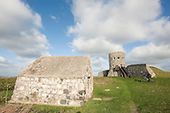 Loophole tower at Rousse, Vale, with powder magazine in foreground. This is one of 15 such towers built on the island in 1778-79. Guernsey, Channel Islands, UK © Rudolf Abraham