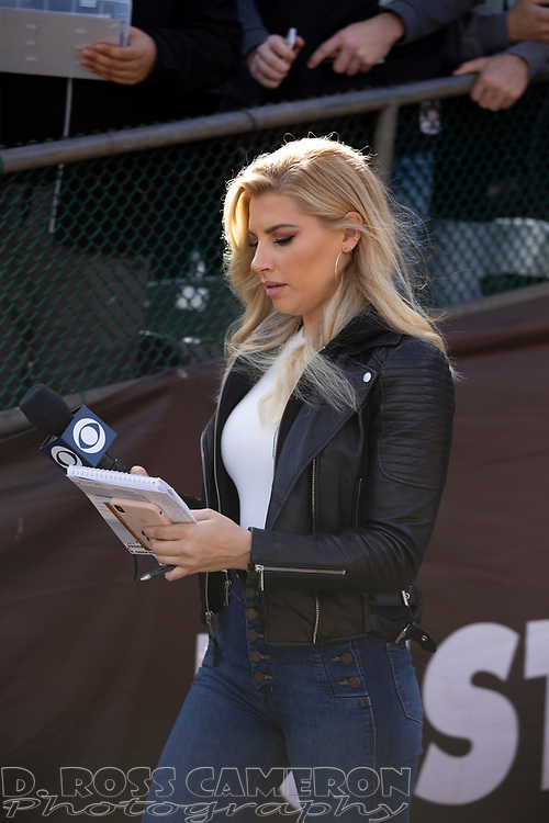 CBS Sports sideline reporter Melanie Collins walks onto the field before an NFL football game between the Tennessee TItans and Oakland Raiders, Sunday, Dec. 8, 2019, in Oakland, Calif. The Titans defeated the Raiders 42-21. (AP Photo/D. Ross Cameron)
