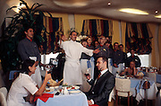Moscow, Russia, July 2002..Restaurant Syr, where the Italian chef and staff seranade customers.....