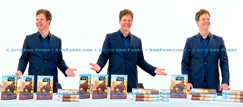 Merrick, New York, U.S.  December 20, 2019.  KEVIN SHINICK, shown in composite of 3 photos, discusses his novel during book signing for STAR WARS: FORCE COLLECTOR at North Merrick Library on Nassau County Force Collector Day. Author Shinick named home planet of Karr Nuq Sin, the main character of this canon Star Wars young adult novel, MEROKIA in honor of Merokee tribe who settled his Merrick hometown on Long Island.