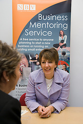 Two women chatting at Nottingham's 'Women's Enterprise Day' exhibition; held at the New Deal for Communities centre,