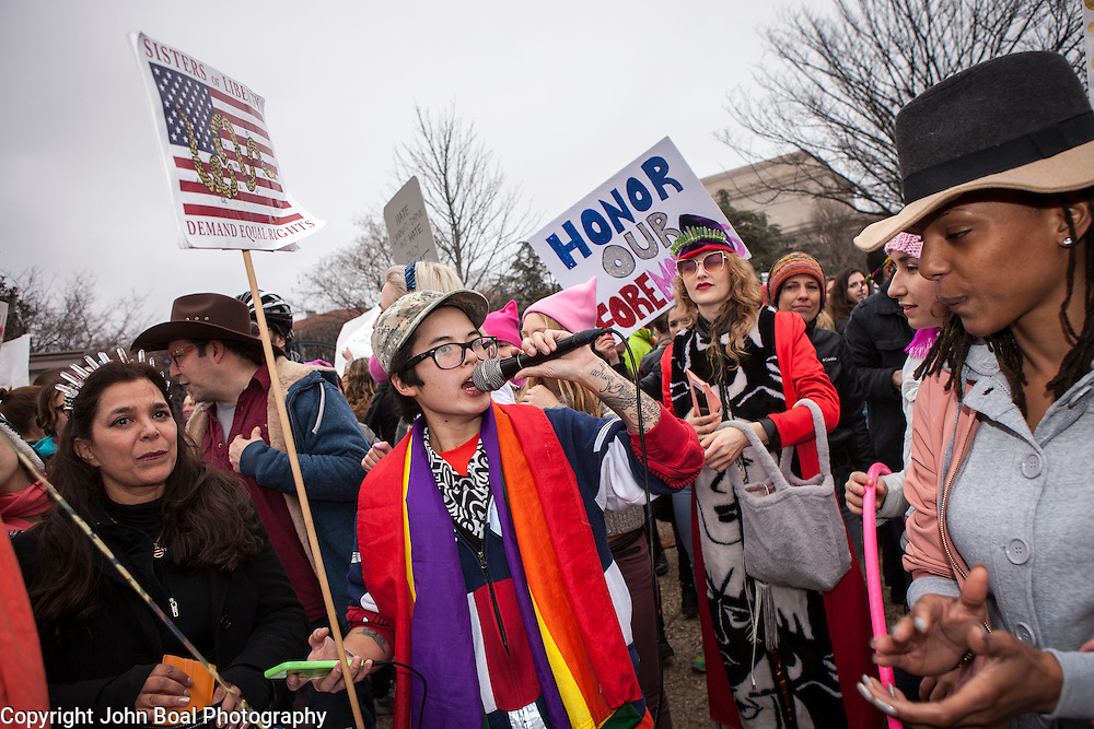 Natalie de Leon, of Sisters of Liberty, speaks to protesters through a microphone on the corner of 7th and Madison, near the National Mall, during the Women's March on Washington where an anticipated 200,000 people turned into an estimated 500,000 to 1 million people, on Saturday, January 21, 2017.  In between speaking to the people as they marched by, they would play music and an people would dance in the street.  John Boal Photography