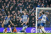 Alireza Jahanbakhsh (Brighton) celebrates his goal on his knees surrounded by Lewis Dunk (Capt) (Brighton), Adam Webster (Brighton), Bernardo Fernandes da Silva Junior (Brighton) & Davy Propper (Brighton) during the Premier League match between Brighton and Hove Albion and Chelsea at the American Express Community Stadium, Brighton and Hove, England on 1 January 2020.