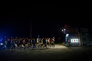 """People run behind organization's van on the 20th Korrika. Castejon (Basque Country). April 1, 2017. The """"Korrika"""" is a relay course, with a wooden baton that passes from hand to hand without interruption, organised every two years in a bid to promote the basque language. The Korrika runs over 11 days and 10 nights, crossing many Basque villages and cities. This year was the 20th edition and run more than 2500 Kilometres. Some people consider it an honour to carry the baton with the symbol of the Basques, """"buying"""" kilometres to support Basque language teaching. (Gari Garaialde / Bostok Photo)"""