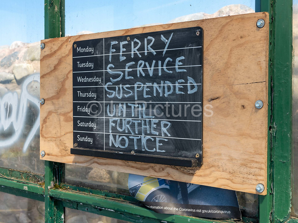 Ferry service suspended sign for the Knott End on Sea to Fleetwood service due to the Coronavirus pandemic on 14th May 2020 in Knott End on Sea, Lancashire, United Kingdom. The Fleetwood to Knott End ferry service provides a vital link for visitors and locals between Fleetwood and Knott End. The ferry journey takes less than 10 minutes.