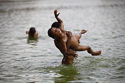 June 1, 2017 - Bhaktapur, Nepal - Nepalese boys somersault at a pond on a hot day in Bhaktapur, Nepal on Thursday, June 01, 2017. (Credit Image: © Skanda Gautam via ZUMA Wire)