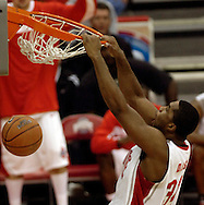 PHOTO BY DAVID RICHARD.Ohio State's Terence Dials slam dunks two of his 19 points Sunday in the second half against visiting Illinois..