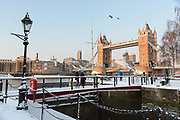 A snow covered bridge in front of Tower Bridge in London, England on February 28th, 2018. Freezing weather conditions dubbed the Beast from the East have brought snow and sub-zero temperatures to the UK.