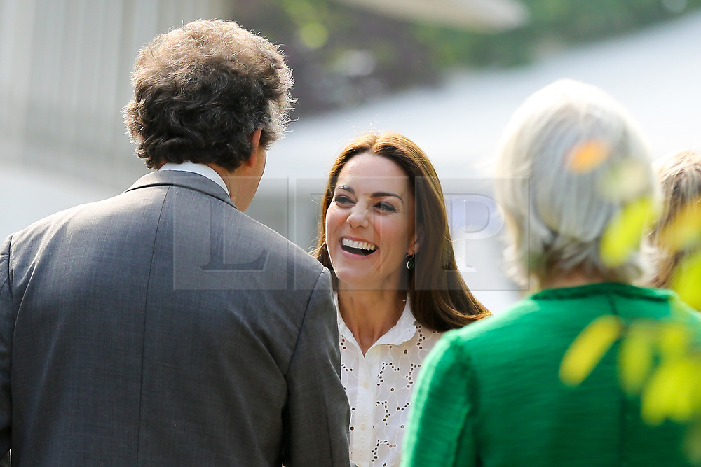 """© Licensed to London News Pictures. 20/05/2019. London, UK. Duchess of Cambridge arrives at her 'Back to Nature' garden at the Chelsea Flower Show. The  'Back to Nature' garden is designed along with the Royal Horticultural Society and landscape architects Davies White which includes a swing seat, hanging below the garden's centrepiece, a high platform tree house as well as """"incredible edibles, plants for craft activities, forest scents and a diverse range of plants, shrubs and trees of different heights and textures,""""<br /> The Royal Horticultural Society Chelsea Flower Show is an annual garden show held over five days in the grounds of the Royal Hospital Chelsea in West London. The show is open to the public from 21 May until 25 May 2019. Photo credit: Dinendra Haria/LNP"""