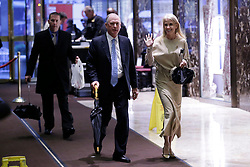 Donald Trump Campaign Manager Kellyanne Conway and Former Vice President Dan Quayle walk through the lobby of Trump Tower on November 29, 2016 in New York City. Photo by John Angelillo/UPI