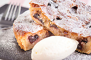 Warm Black Cherry Bakewell Tart with Clotted Cream Ice Cream pictured at P&O Cruises Development Kitchen for the Macmillan Cancer Support cookery book.<br /> Picture date: Friday April 29, 2016.<br /> Photograph by Christopher Ison ©<br /> 07544044177<br /> chris@christopherison.com<br /> www.christopherison.com