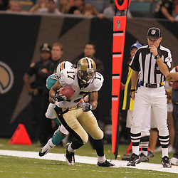 2008 August 28: Wide receiver, Robert Meachem (17) of the New Orleans Saints is tackled by Yeremiah Bell (37) of the Miami Dolphins during a preseason game at the Louisiana Superdome in New Orleans, LA.