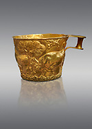 Vapheio type Mycenaean gold cup depicting a wild bull hunt , Vapheio Tholos Tomb, Lakonia, Greece. National Archaeological Museum of Athens.  Grey Background<br /> <br /> <br />  Two masterpieces of Creto - Mycenaean gold metalwork were excavated from a tholos tomb near Lakonia in Sparta in 1988. Made in the 15th century BC, the gold cups are heavily influenced by the Minoan style that was predominant in the Agean at the time. The bull hunt was popular with  Mycenaean  and Minoan artists and symolised power and fertility. The distinctive shape of the cup is kown as 'Vapheio type'. .<br /> <br /> If you prefer to buy from our ALAMY PHOTO LIBRARY  Collection visit : https://www.alamy.com/portfolio/paul-williams-funkystock/mycenaean-art-artefacts.html . Type -   Athens    - into the LOWER SEARCH WITHIN GALLERY box. Refine search by adding background colour, place, museum etc<br /> <br /> Visit our MYCENAEN ART PHOTO COLLECTIONS for more photos to download  as wall art prints https://funkystock.photoshelter.com/gallery-collection/Pictures-Images-of-Ancient-Mycenaean-Art-Artefacts-Archaeology-Sites/C0000xRC5WLQcbhQ