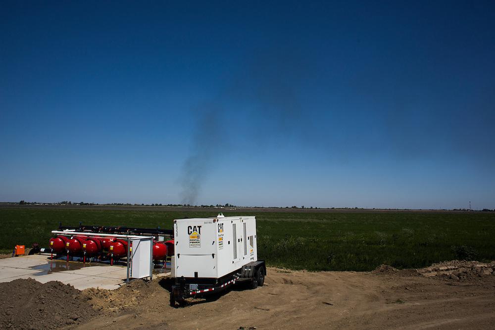 A generator powers well pumps near Firebaugh, CA.  April 13, 2015