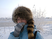 Youg woman is protecting her respiratory tract to breath easier on a day with -31 degrees Celsius during a walk in the city center of Yakutsk. Yakutsk is a city in the Russian Far East, located about 4 degrees (450 km) below the Arctic Circle. It is the capital of the Sakha (Yakutia) Republic (formerly the Jakut Autonomous Soviet Socialist Republic), Russia and a major port on the Lena River. Yakutsk is one of the coldest cities on earth, with winter temperatures averaging -40.9 degrees Celsius.