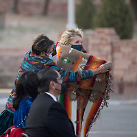 Council delegate Eugenia Charles-Newton wraps a blanket around the First Lady of the United States Jill Biden at Navajo Tribal Park & Veterans Memorial in Window Rock Thursday, April 22 before she delivers a live radio address to the Navajo Nation. The blanket was a gift from the 24th Navajo Nation Council.