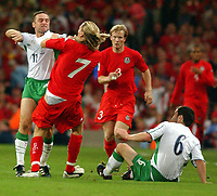 Photo. Daniel Hambury.<br /> 2006 FIFA World Cup Qualifier.  08/09/2004.<br /> <br /> Wales V Northern Ireland<br /> <br /> Wales' and Northern Ireland's Michael Hughes square up to each other