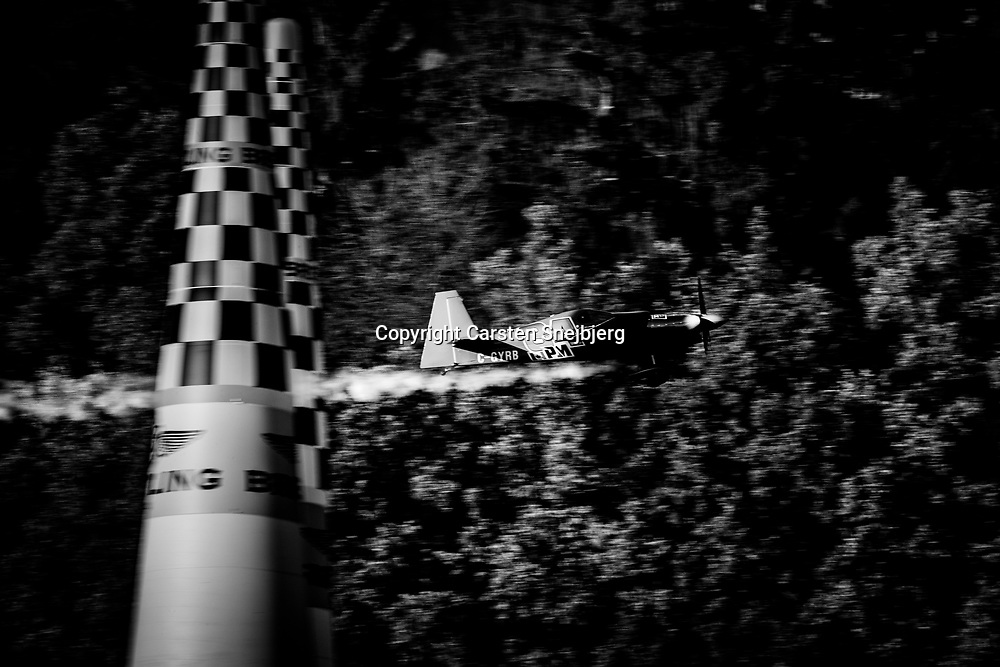 Plane in action on the pitch. All the aircrafts in the race are equipped with smoke cannons so judges can see that they come right in through the gates.