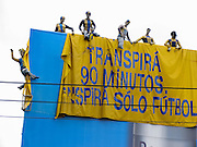 """The most popular sport in Argentina is association football or fútbol (called soccer in the USA). La Boca is known among sports fans for La Bombonera stadium (Estadio Alberto J. Armando), home of Boca Juniors, one of the world's best known football (soccer) clubs. The Argentine national football team has won 25 major international titles including two FIFA World Cups, two Olympic gold medals, and fourteen Copa Américas. Over one thousand Argentine players play abroad, the majority of them in European football leagues. Increasing numbers of girls and women have organized their own national championships since 1991 and were South American champions in 2006. The Argentine Football Association (AFA) was formed in 1893. A billboard near the national stadium says """"Transpirá 90 minutos. Inspira sólo fútbol"""" (""""90 minutes transpires, only football inspires."""""""